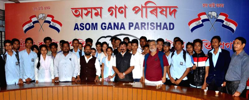 AGP chief Atul Bora with the newly joined party members at party head office in Guwahati on Dec 4, 2014.