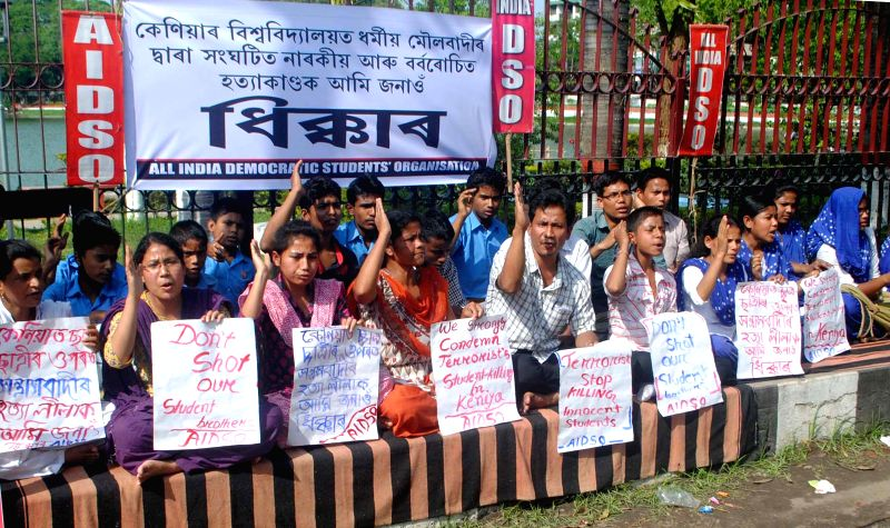 AIDSO activists stage a demonstration against the recent violence at a Kenyan university, in Guwahati, on April 6, 2015.