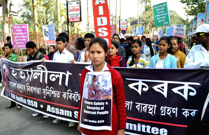 AIDSO activists stage a demonstration to protest against the recent Assam violence in which 73 people were killed, in Guwahati on Dec 28, 2014.