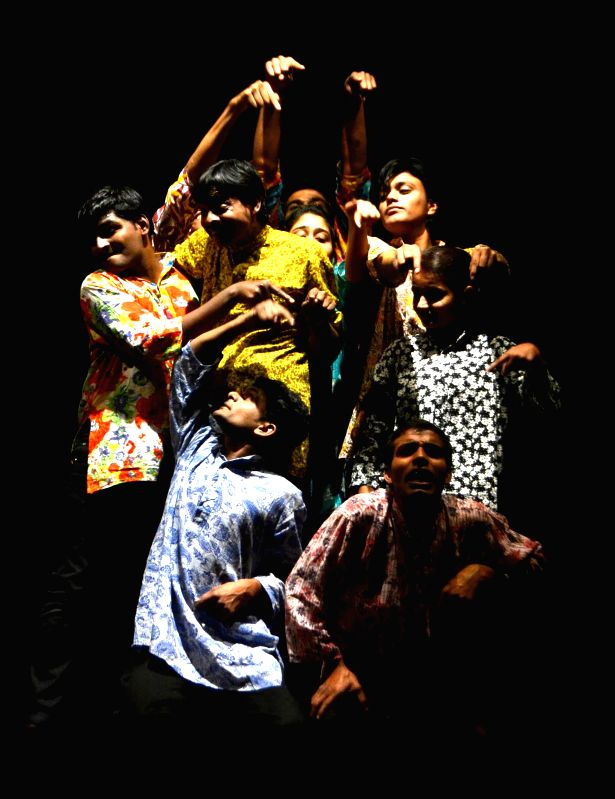 Artists of Backstage, Allahabad performs a drama `Tees Mar Khan` directed by Pravin Shekhar during the 4th National Children Theatre Festival at Rabindra Bhawan in Guwahati on Jan 3, 2015.