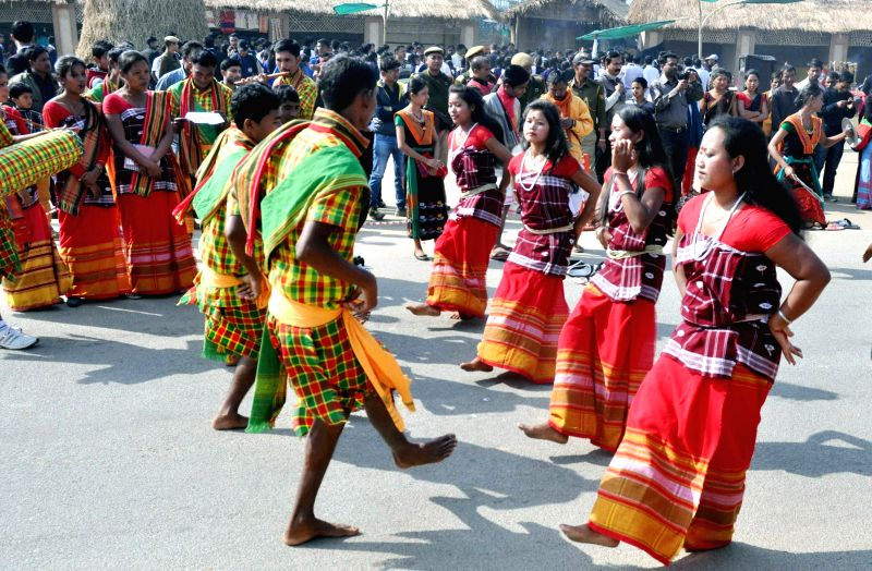 Artists perform during the Bhogali Utsav 2015 organised by Assam Tourism at Sarusajai Stadium in Guwahati on Jan 18, 2015.