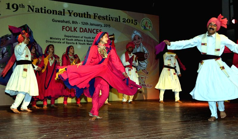 Artists perform during the Folk Dance Competition  at the ongoing 19th National Youth Festival 2015 in Guwahati, on Jan 9, 2015.