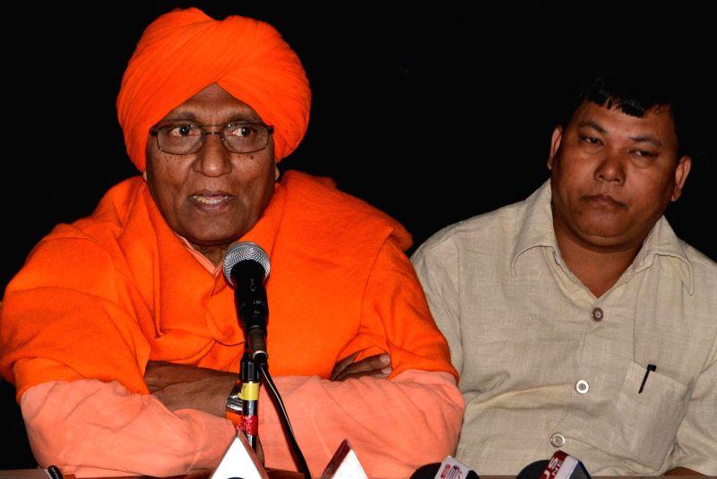 Arya Samaj leader Swami Agnivesh addresses a press conference after visiting the violence hit Sontitpur district of Assam, in Guwahati, on Jan 7, 2015.