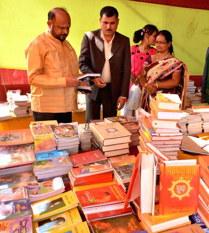 Asom Gana Parishad (AGP) president Prafulla Kumar Mahanta accompanied by his wife Jayashree Mahanta at a book stall during Asam Sahitya Sabha`s 73rd 2nd annual conference at Pandit Atmaram . - Prafulla Kumar Mahanta