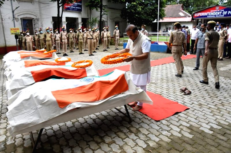 Guwahati: Assam Chief Minister Himanta Biswa Sarma pays homage to 6 police personnel who died during violence at Assam-Mizoram border at Silchar in Assam on Tuesday, July 27, 2021.(Photo: Anuwar hazarika/IANS)