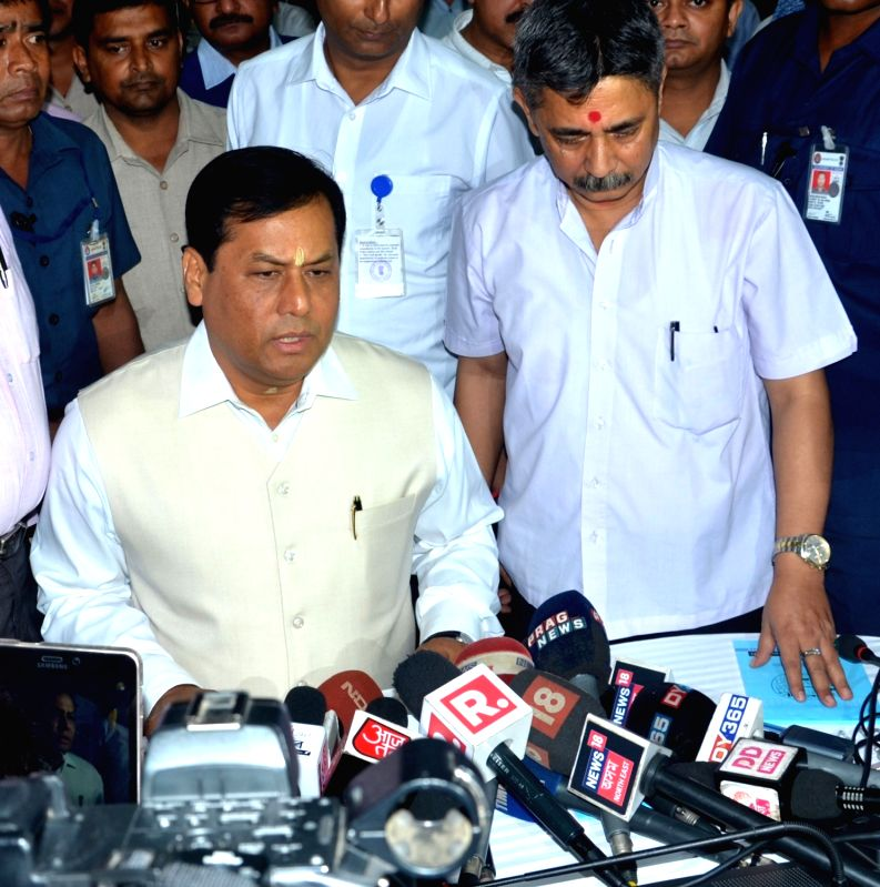 :Guwahati: Assam Chief Minister Sarbananda Sonowal addresses a press conference after the state's first complete draft of the National Register of Citizens (NRC) was published today; in ...