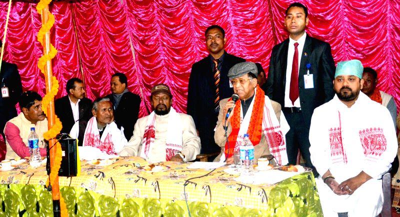 Assam Chief Minister Tarun Gogoi addresses during a programme organised on Bhogali Bihu in Sonapur of  Guwahati on Jan 14, 2015. - Tarun Gogoi