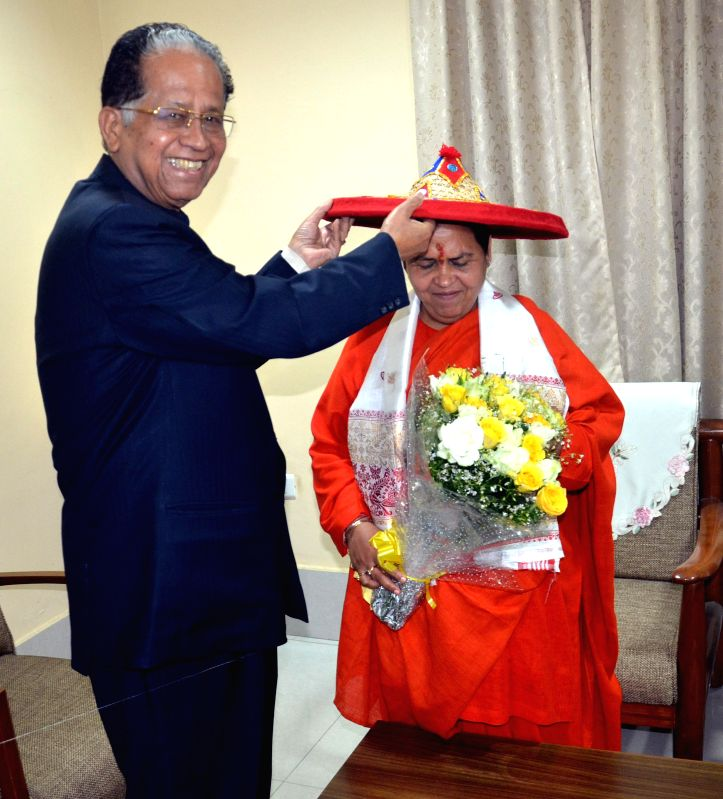 Assam Chief Minister Tarun Gogoi felicitates Union Minister for Water resource, River Development and Ganga Rejuvenation Uma Bharti in Guwahati, on Feb 10, 2015. - Tarun Gogoi