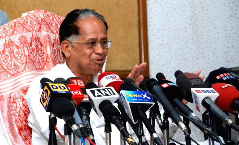 Assam Chief Minister Tarun Gogoi addresses a press conference at the Assam secretariat, in Guwahati on April 23, 2015.