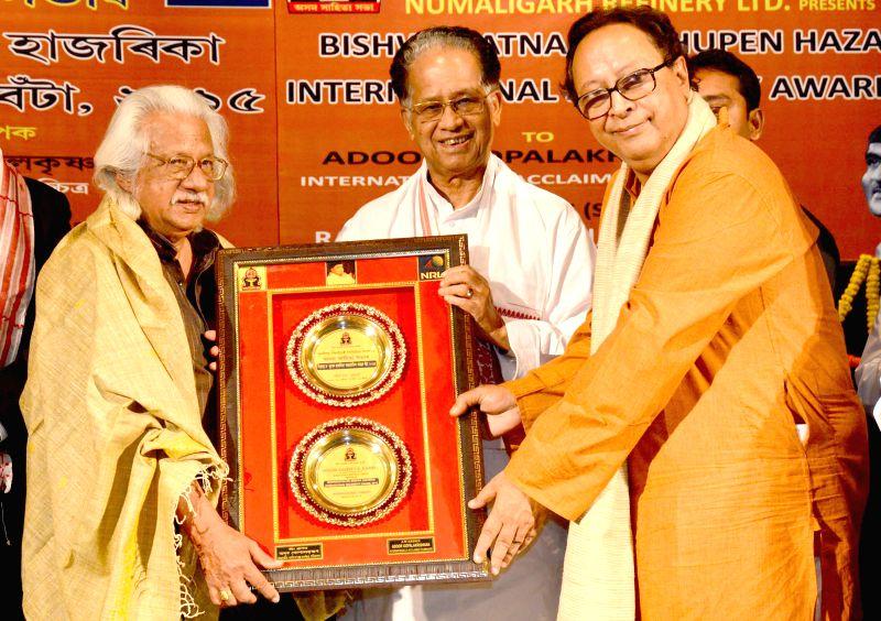 Assam Chief Minister Tarun Gogoi and Asam Sahitya Sabha chief Dr. Dhrubajyoti Bora confer the Bishwaratna Dr. Bhupen Hazarika International Solidarity Award, 2015 to filmmaker Adoor ... - Tarun Gogoi