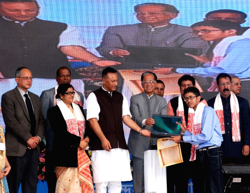 Assam Chief Minister Tarun Gogoi during `Anundoram Barooah Award - 2014` distribution ceremony at Veterinary College Playground, Khanapara, Guwahati on Dec 23, 2014. - Tarun Gogoi