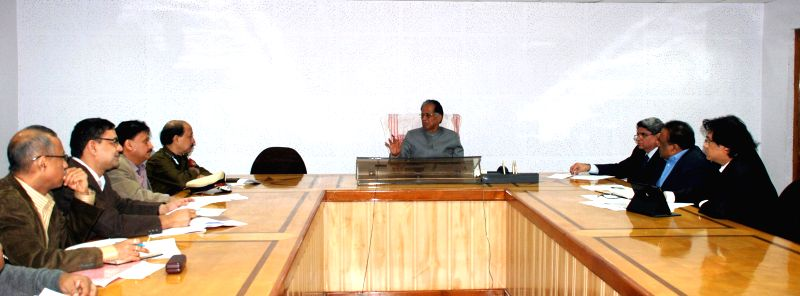 Assam Chief Minister Tarun Gogoi during a review meeting of relief and rehabilitation work for violence affected people in Guwahati, on Dec 26, 2014.