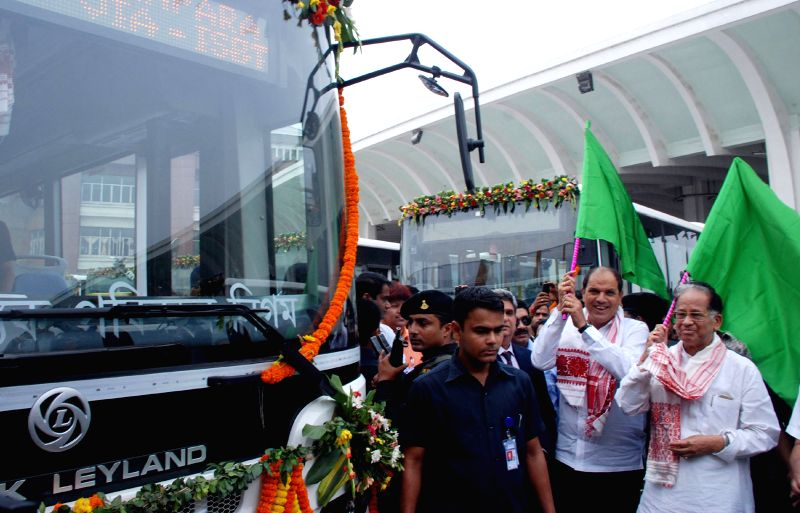 Assam Chief Minister Tarun Gogoi flags-off JNNURM City Bus Service during a programme at Inter-State Bus Terminus in Guwahati on March 30, 2015.