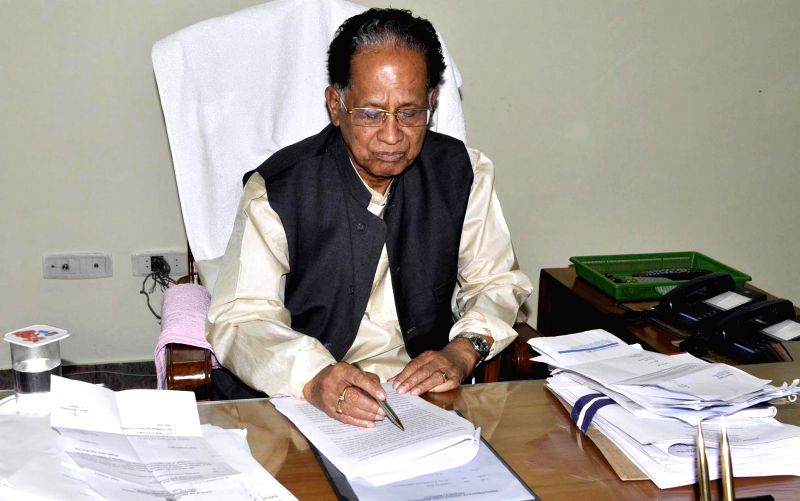 Assam Chief Minister Tarun Gogoi gives final touches to the state's Annual Budget 2015-16 at the Assam assembly in Guwahati, on March 9, 2015. - Tarun Gogoi