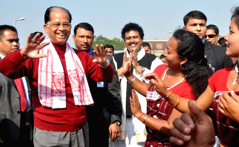 Assam Chief Minister Tarun Gogoi tries a few steps of Bihu dance during the Bhogali Utsav 2015 organised by Assam Tourism at Sarusajai Stadium in Guwahati on Jan 18, 2015. - Tarun Gogoi