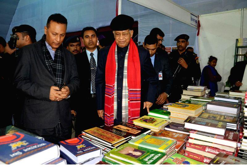 Assam Chief Minister Tarun Gogoi visits the 28th Guwahati Book Fair at AEI playground, Chandmari in Guwahati on Jan 4, 2015. - Tarun Gogoi