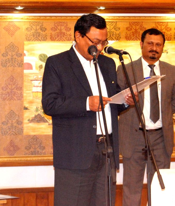Assam Governor P B Acharya administers oath of office to Rockybul Hussein as a minister at a function in Raj Bhawan in Guwahati, on Jan 23, 2015.