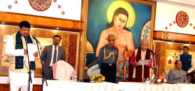 Assam Governor P B Acharya administers oath of office to Nazrul Islam as a minister at a function in Raj Bhawan in Guwahati, on Jan 23, 2015.