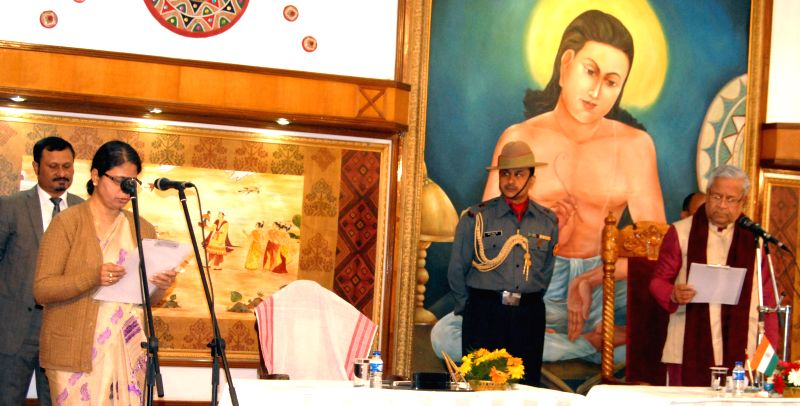 Assam Governor P B Acharya administers oath of office to Ajanta Neogi as a minister at a function in Raj Bhawan in Guwahati, on Jan 23, 2015.