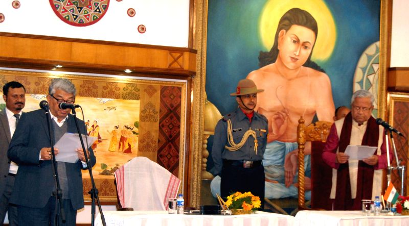 Assam Governor P B Acharya administers oath of office to Sharat Barkatoki as a minister at a function in Raj Bhawan in Guwahati, on Jan 23, 2015.