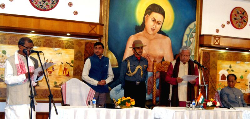 Assam Governor P B Acharya administers oath of office to Dr Bhumidar Barman as a minister at a function in Raj Bhawan in Guwahati, on Jan 23, 2015.