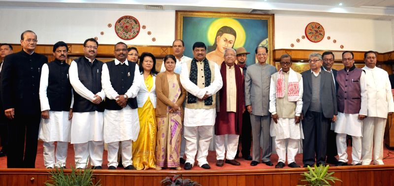 Assam Governor P B Acharya and Chief Minister Tarun Gogoi with the New Council of Ministers at a function organised in Raj Bhawan in Guwahati on Jan 23, 2015. - Tarun Gogoi