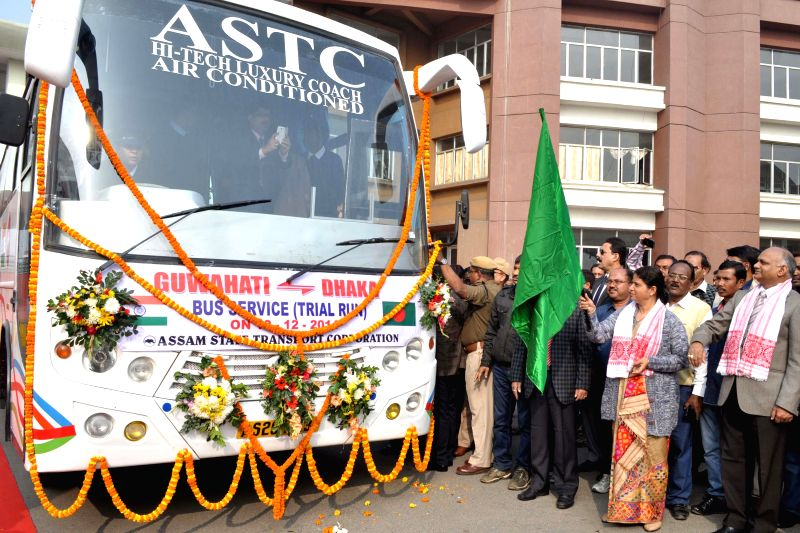 Assam PWD and Urban Development Minister Ajanta Neog flags-off Guwahati-Dhaka bus service at Guwahati ISBT on Dec 10, 2014. - Ajanta Neog