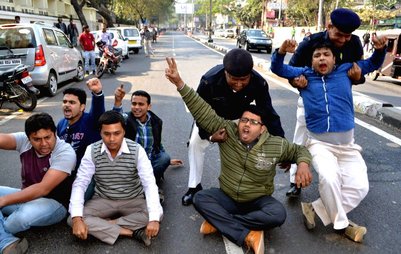 Bandh supporters stage a demonstration during a 12-hour Assam bandh called by All Adivasi Students Association (AASA) to protest against the recent Assam violence that left 73 people dead, .