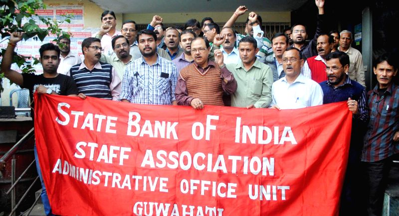 Bank employees stage a demonstration  to press for their demands in Guwahati on Dec 4, 2014.