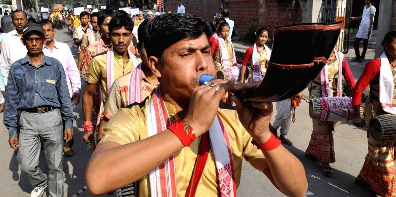 Bihu dancers participate in a cultural procession organised during Assam Sanskriti Mahotsav - 2014 in Guwahati, on Nov 18, 2014.