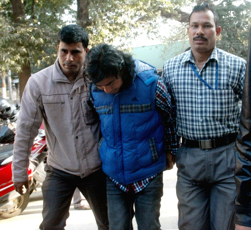 Birlangbai, a self styled commander of the 13th battalion of NDFB(S) being taken to be produced before a court in Guwahati, on Jan 20, 2015.