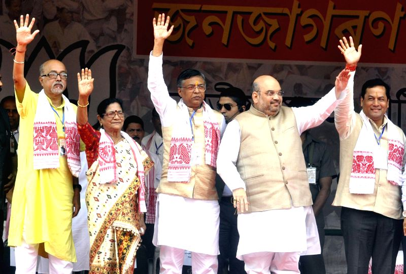 BJP chief Amit Shah during Mahajagaran Samaroh - a BJP rally in Guwahati, on April 26, 2015. Also seen the Union Minister of State (Independent Charge) for Youth Affairs and Sports ...