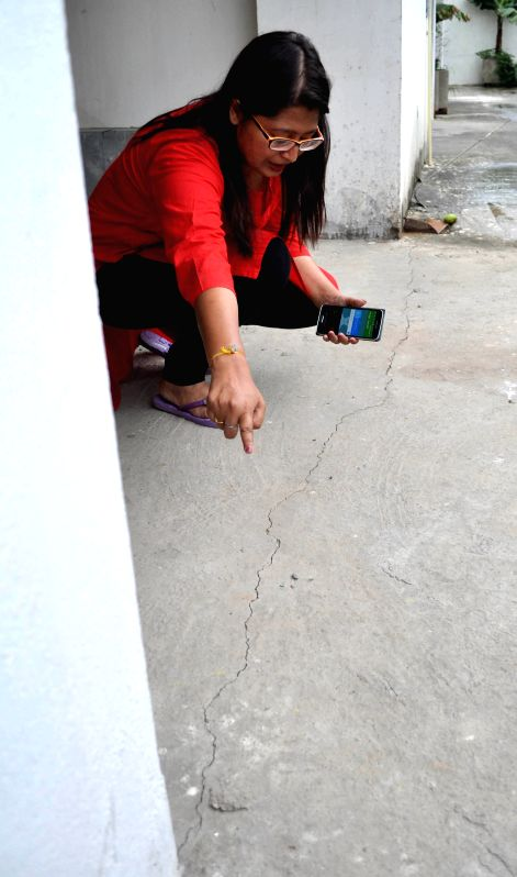 Cracks appear on the floor of a building at Beltola, Chandan Nagar after earthquake in Guwahati on April 25, 2015. According to the India Meteorological Department, the depth of earthquake ...