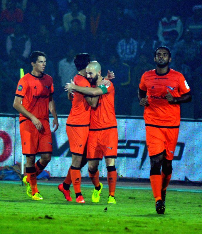 Delhi Dynamos FC players celebrate a goal during an ISL match between NorthEast United FC and Delhi Dynamos FC at Indira Gandhi Athletic Stadium in Guwahati, on Nov 24, 2014.