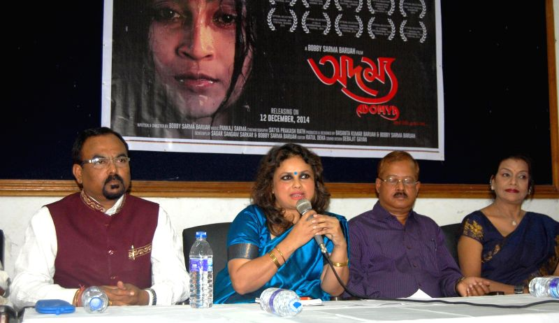 Film director Bobby Sarma Baruah addresses a press conference regarding her film `Adomya, Life goes on` in Guwahati on Nov 29, 2014.