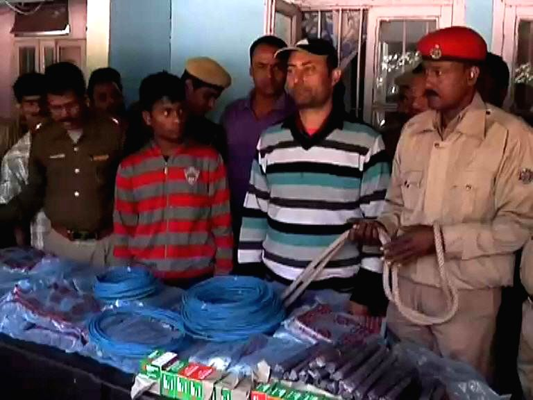 Guwahati police displays 1800 gelatin sticks, 500 detonators, 12 rolls of cordex (fuse) wire recovered by them on Nov 27, 2014. The recovery has been made two days before Prime Minister ... - Narendra Modi and Rajnath Singh