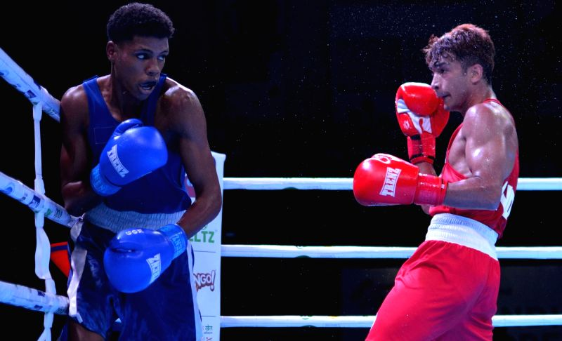 Guwahati: India's Shiva Thapa in action against Damien Hellene of Mauritius during the 2nd India Open International Boxing Tournament, in Guwahati on May 22, 2019.