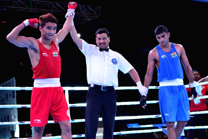 Guwahati: India's Shiva Thapa (Red) after winning the finals in the 60 Kg category against Manish Kaushik (Blue) of India during the second edition of India Open International Boxing Tournament 2019 at Nabin Chandra Bordoloi Stadium in Guwahati, on M