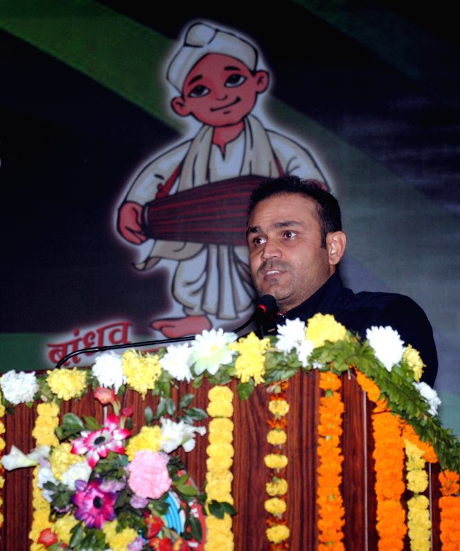 Indian cricketer Virender Sehwag addresses during 19th National Youth Festival 2015  in Guwahati on Jan 11, 2015.