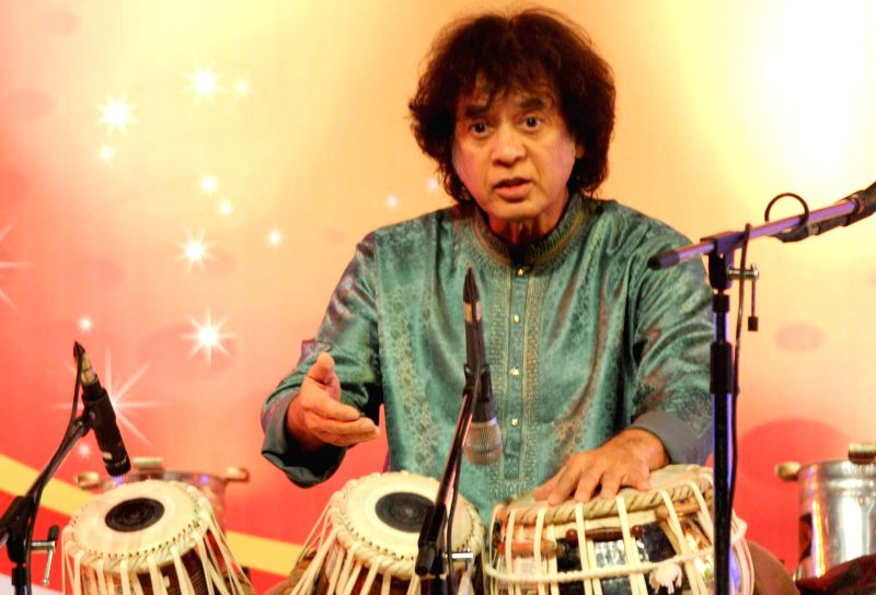 Indian tabla player Zakir Hussain performs during a programme in Guwahati, on Feb 17, 2015.