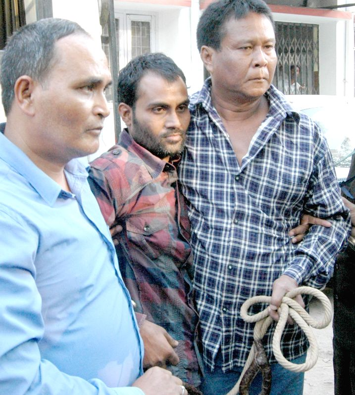 Jihadi terrorist Sahanur Alom alias Doctor babu(M)  was arrested by NIA with the help of Assam police and CRPF personnel being produced at CJM Court in Guwahati on Dec 6, 2014.
