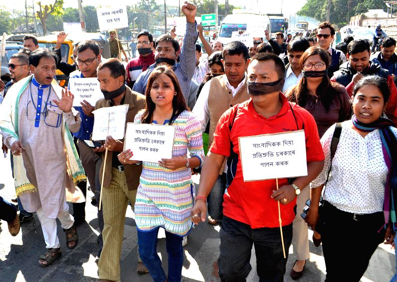 Journalists stags a protest in front of Secretariat of Dispur against physical harassment of two journalist of DY 365 TV Channel, by Latasil Police in Guwahati on Feb. 2, 2015.