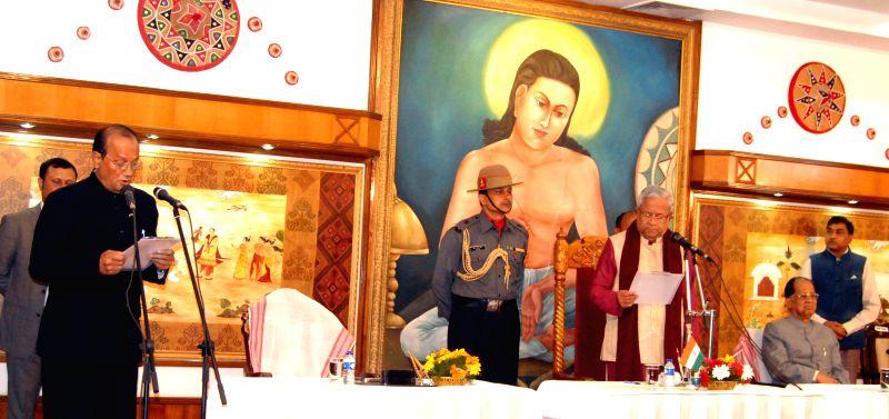 Kharsing Ingti  swears in as a minister at a function in Raj Bhawan in Guwahati, on Jan 23, 2015.