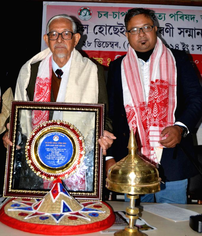 Noted Scholar Hiren Goha being felicitated with Dr.Ismail Hussain Memorial Harmony Award by Char Sapori Sahitya Parishad, a literary body of Assam, in Guwahati, on Dec 28, 2014.