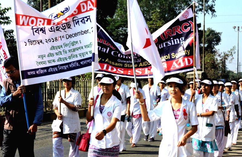 People participate in an AIDS awareness rally organised on World AIDS Day in Guwahati on Dec 1, 2014.
