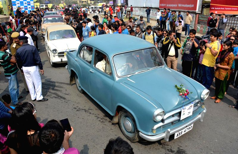 People participate in the 3rd Vintage Car rally in Guwahati on Feb 8, 2015.