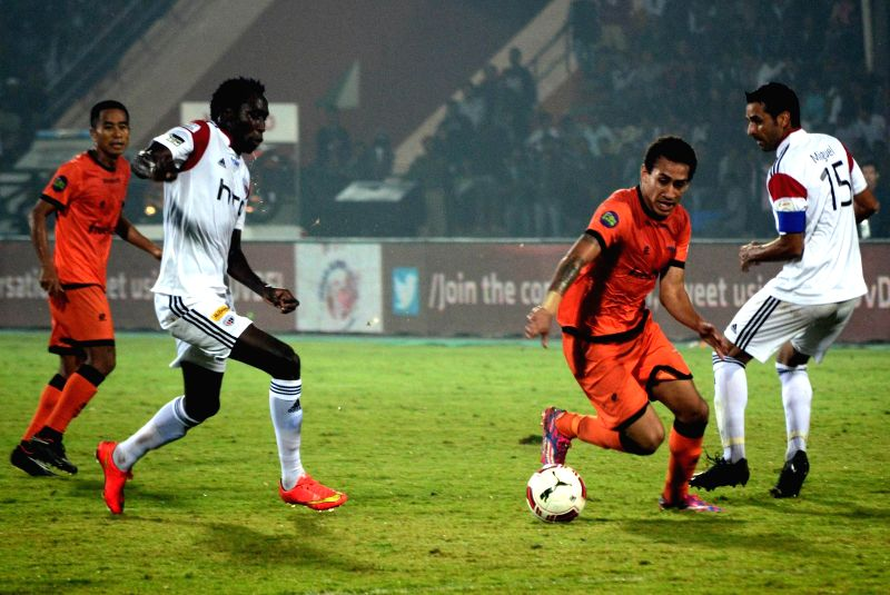 Players in action during an ISL match between NorthEast United FC and Delhi Dynamos FC at Indira Gandhi Athletic Stadium in Guwahati, on Nov 24, 2014.