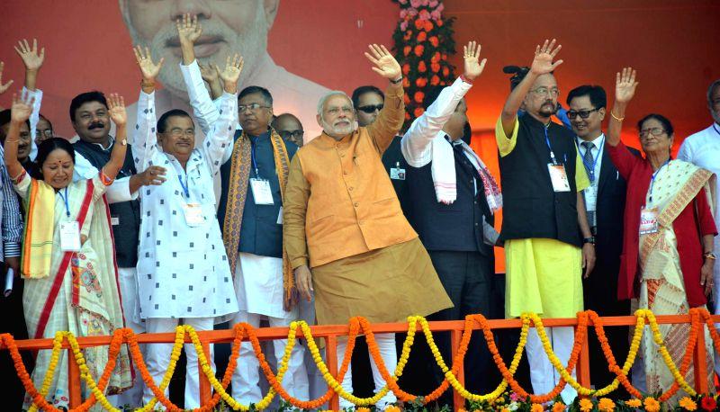 Prime Minister Narendra Modi during a BJP meeting at Indira Gandhi Athletic Stadium in Guwahati on Nov 30, 2014. - Narendra Modi