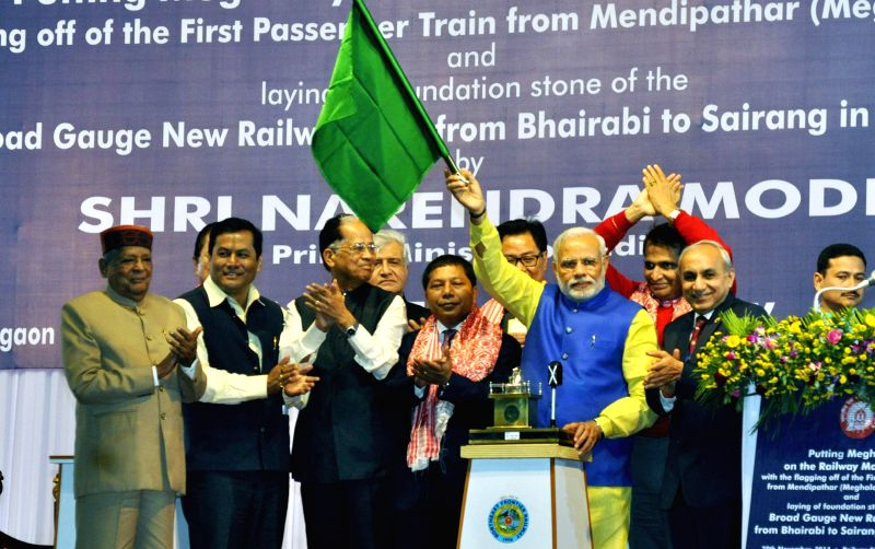 Prime Minister Narendra Modi in the presence of Assam Chief Minister Tarun Gogoi and Assam Governor J.B. Patnaik flags off the first train from Mendipathar in North Garo Hills of Meghalaya . - Narendra Modi