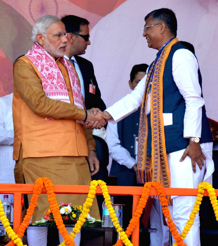 Prime Minister Narendra Modi with Assam BJP chief Siddhartha Bhattacharjee during a BJP meeting at Indira Gandhi Athletic Stadium in Guwahati on Nov 30, 2014. - Narendra Modi